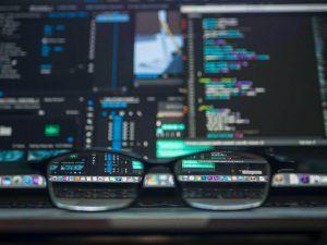 Zeumic Website Development St Kilda-Glasses and Code Screen